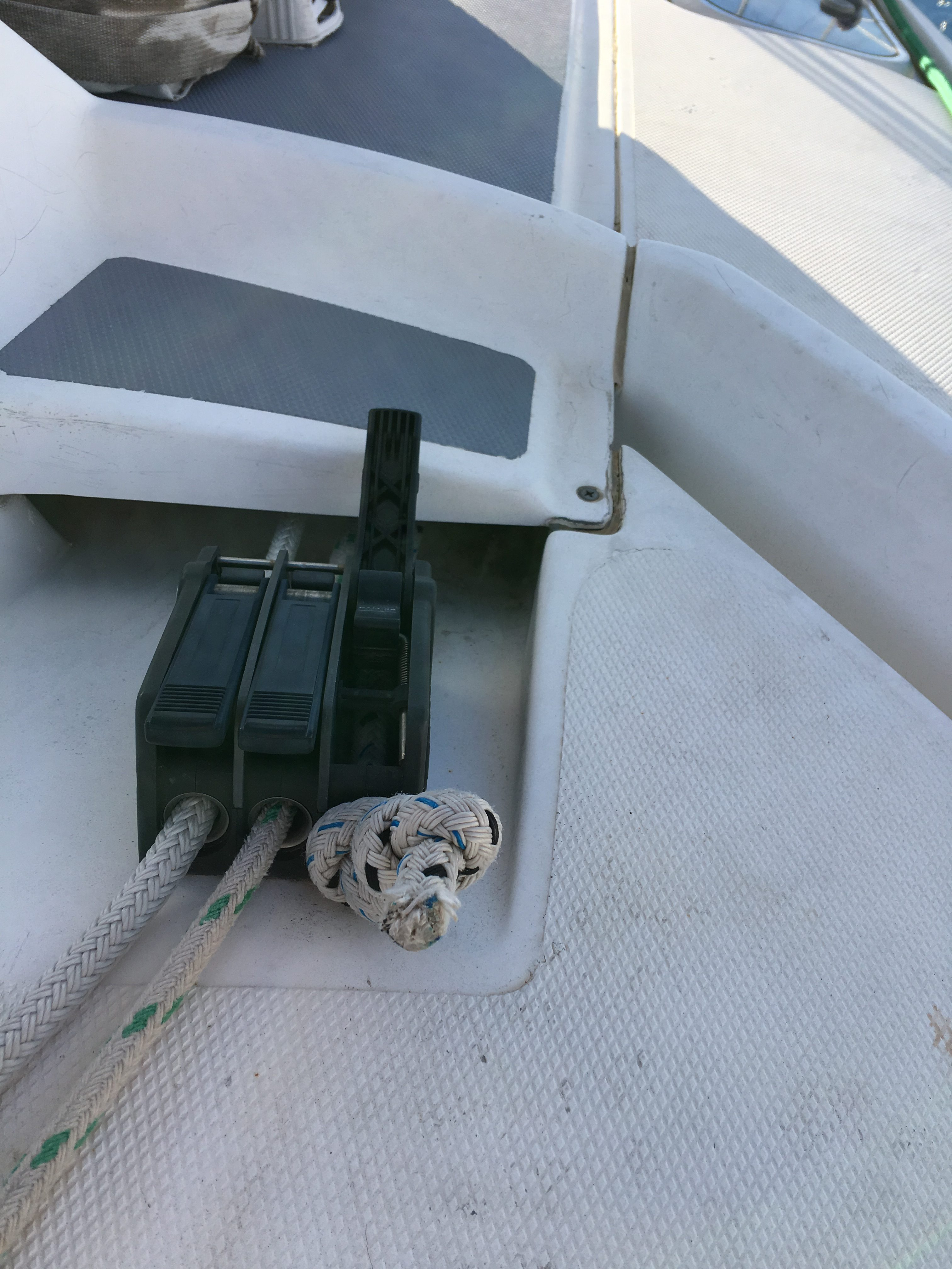 Rope tight up against a clutch on a sailing yacht.