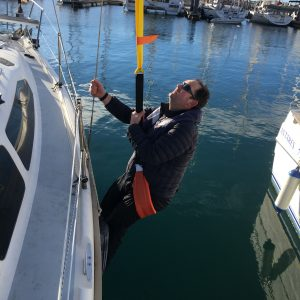 Andy Burton being lifted onboard a yacht using an I C Brindle recovery strop