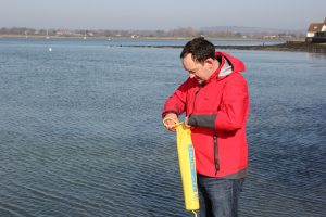 Picture of Andy Burton opening a Plastimo Rescue Line up before throwing it