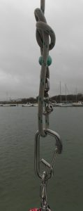 Picture of a bowline on the spinnaker halyard with the top of block and tackle clipped on.